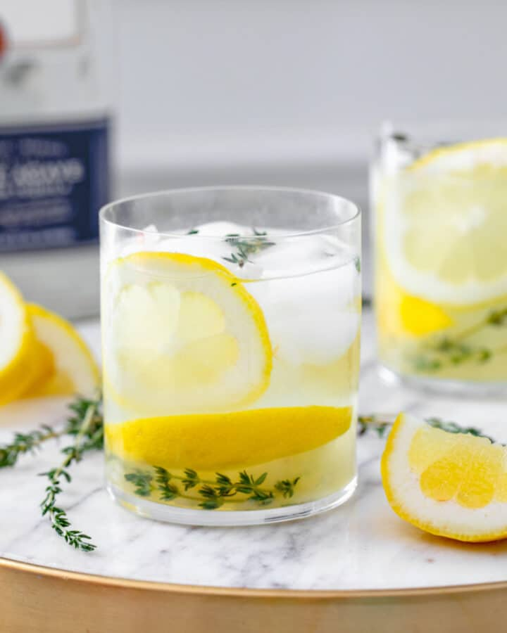 This Tequila Thyme Lemonade is a super simple summer cocktail made with homemade lemonade and fresh thyme. It's light and refreshing and perfect for enjoying in the sunshine!