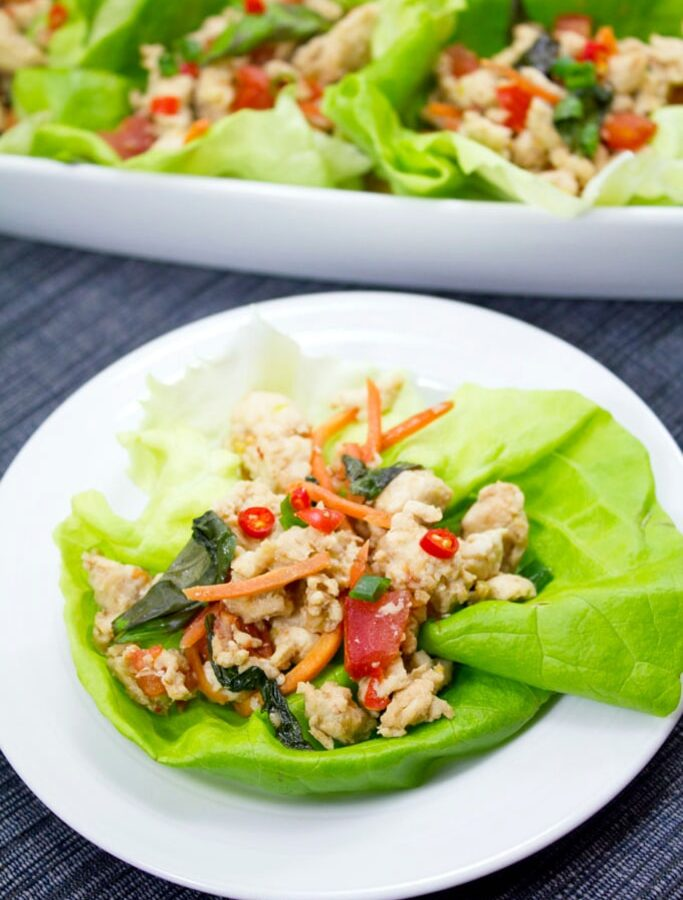 If you love Thai food and are trying to eat healthier, skip the take-out and make these Thai Chicken Basil Lettuce Wraps at home! They're low carb and packed with flavor, with a spice level that can easily be adjusted according to your preference.