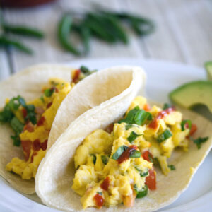 Thai Scrambled Egg Tacos -- These Thai Scrambled Egg Tacos take creamy scrambled eggs packed with spicy Thai flavors and serve them on tortillas for a breakfast you'll dream about | wearenotmartha.com