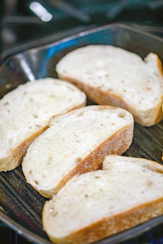 Bread being toasted in a grill pan