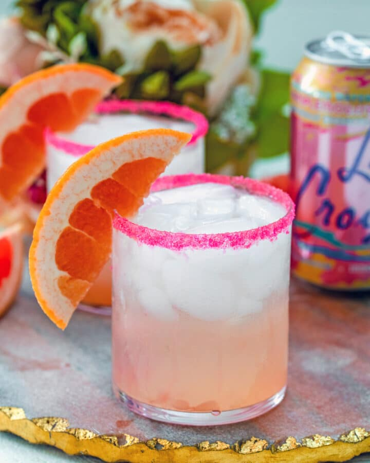 Grapefruit, grapefruit, grapefruit! With this easy-to-make Triple Grapefruit Fizz drink, you'll combine grapefruit vodka, fresh grapefruit juice, and grapefruit seltzer for one delicious citrus cocktail.