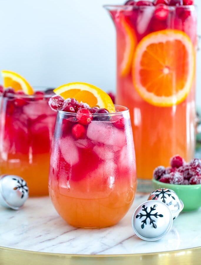 Tropical Cranberry Sangria -- Your favorite summer drink just transitioned to winter! This Tropical Cranberry Sangria is made with Mija Sangria, orange juice, and fresh cranberry juice. It will have you serving winter sangria all holiday season long | wearenotmartha.com