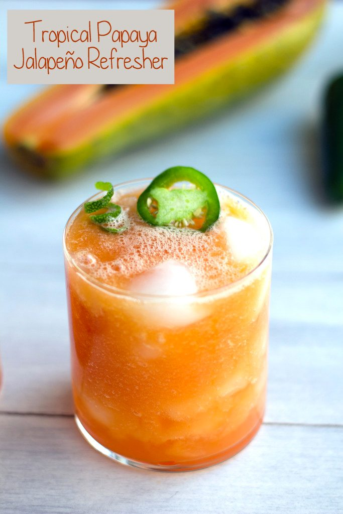 Tropical Papaya Jalapeno Refresher -- A spicy papaya cocktail with tequila, coconut water, and lime |wearenotmartha.com