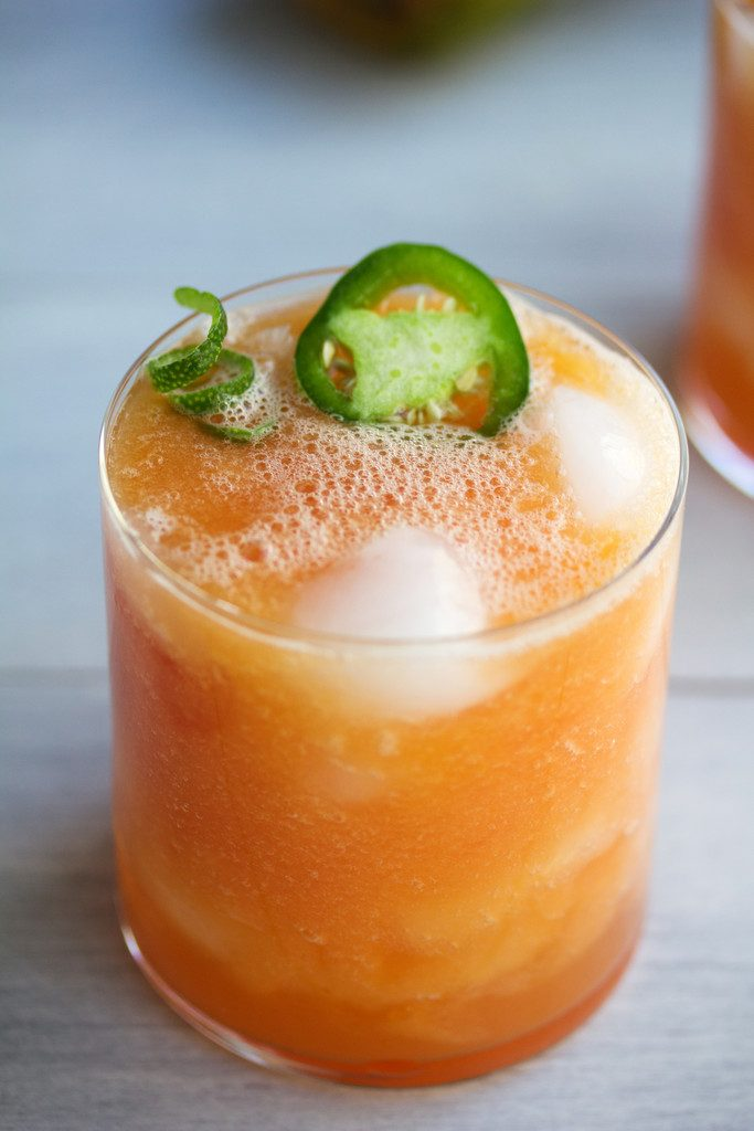 Tropical Papaya Jalapeno Refresher -- A spicy papaya cocktail with tequila, coconut water, and lime  wearenotmartha.com