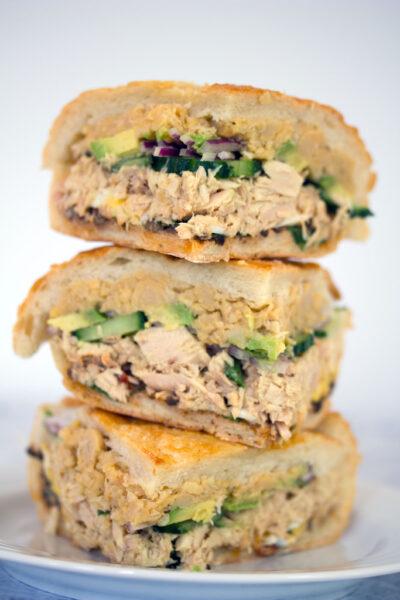 Tuna Nicoise Sandwich -- The layered sandwich includes tuna, eggs, avocado, chickpeas, and more! | wearenotmartha.com