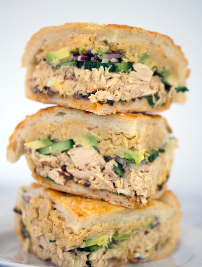 Tuna Nicoise Sandwich -- The layered sandwich includes tuna, eggs, avocado, chickpeas, and more! | wearenotmartha.com