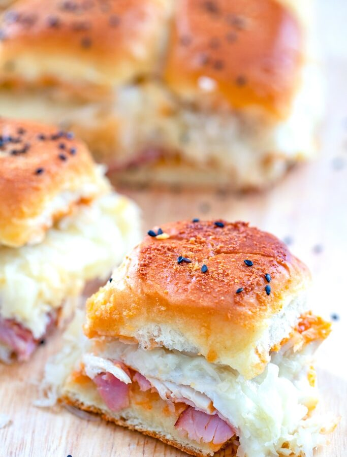Turkey, Ham, and Swiss BBQ Reuben Sliders -- Looking for an easy party recipe that will take no time at all and seriously impress your guests? These BBQ Reuben Sliders can be prepped in mere minutes and will be loved by everyone | wearenotmartha.com