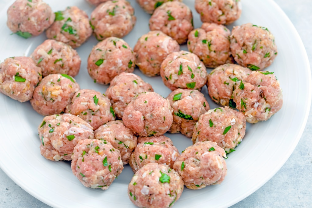 View of turkey meatballs formed on a plate