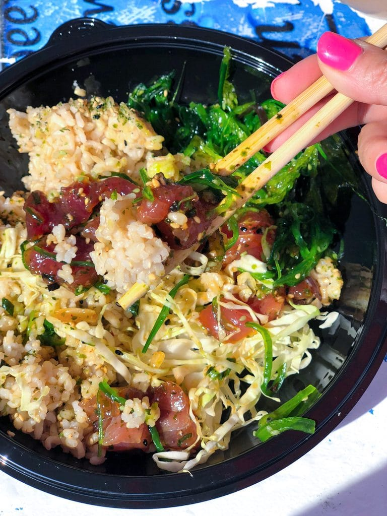 Poke bowl with lots of tuna, seaweed salad, and brown rice all mixed together with chopsticks at Umeke's in Kona on the Big Island of Hawaii