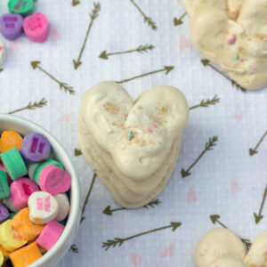 Valentine's Day Heart Meringues -- Incorporate conversation hearts into this sweet treat | wearenotmartha.com