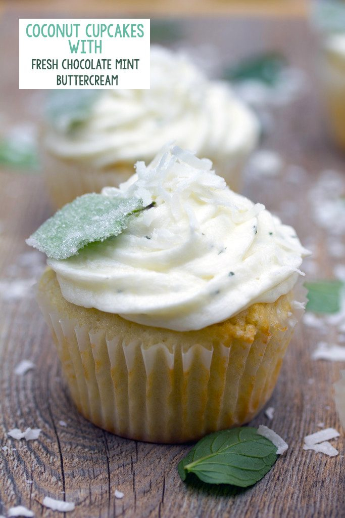 Head-on view of a coconut cupcake with white chocolate mint buttercream with shredded coconut and a sugared mint leaf on top  with recipe title at top of picture