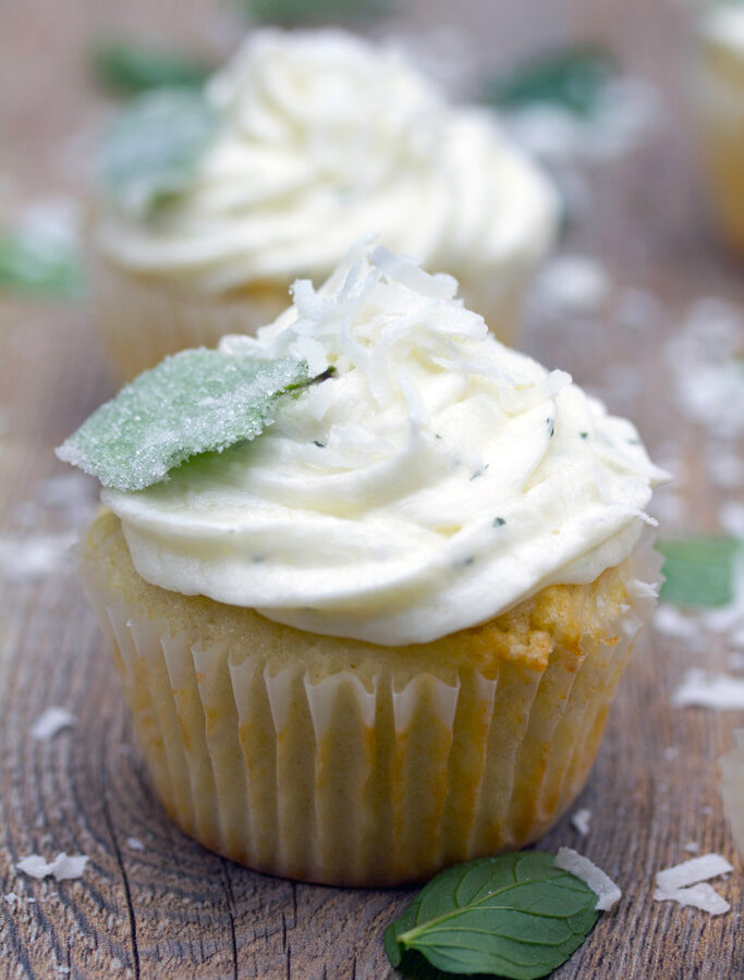 Coconut Cupcakes with Fresh Chocolate Mint Buttercream -- Have a plethora of fresh chocolate mint in your herb garden this season? Make these super moist and fluffy  Coconut Cupcakes with Fresh Chocolate Mint Buttercream | wearenotmartha.com