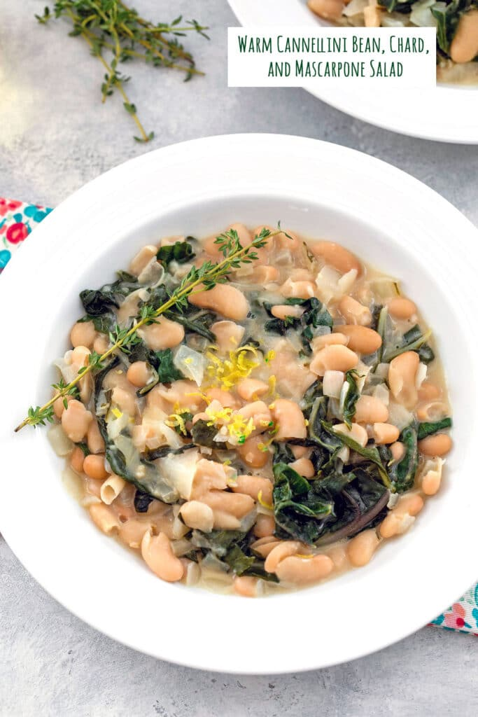 Overhead view of warm cannellini bean salad with chard, marscarpone, fresh thyme sprigs, and lemon zest with recipe title at top