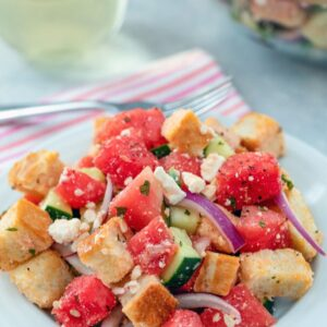 Watermelon Panzanella -- This may not be a traditional panzanella salad, but Watermelon Panzanella Salad is packed with fresh summer ingredients (along with some carbs and cheese, of course) and is the perfect summer side dish | wearenotmartha.com