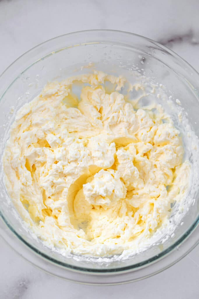 Overhead view of homemade whipped cream in a bowl