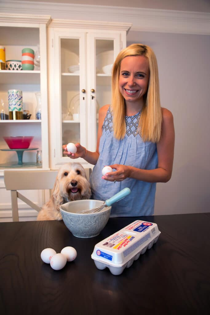 Sues and Winnie together at the table with mixing bowl, whisk, and eggs