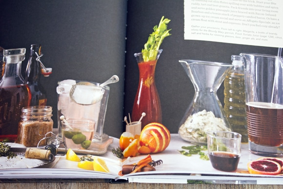 Overhead view of open Winter Cocktails book showing various cocktails