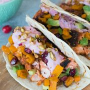 Winter Salmon Tacos with Butternut Squash Salsa and Cranberry Crema -- These fish tacos let you celebrate the winter season while sticking to a healthy eating plan! Packed with lots of winter flavors, algae oil is used to boost good fats | wearenotmartha.com