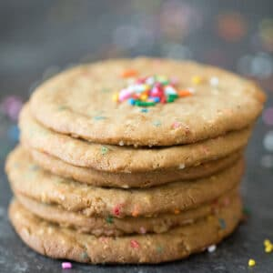 The only thing better than peanut butter cookies are extra large peanut butter cookies packed with rainbow sprinkles and toasted oats. You're still allowed to have more than one, trust me! | wearenotmartha.com #cookies #peanutbutter #sprinkles